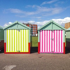 candy striped beach huts