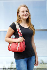 casual young woman with handbag