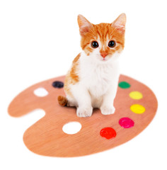 Little kitten with art palette isolated on white