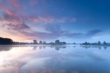 sunrise sky reflected in river