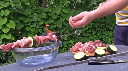 male prepare shashlik on skewer dinner in garden near grill