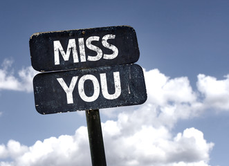 Miss You sign with clouds and sky background