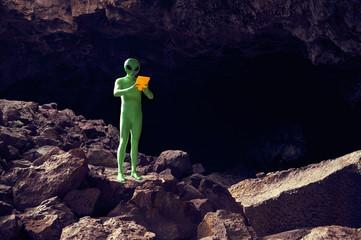 Explorer Alien Using Tablet in Dramatic Landscape
