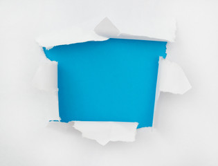 The torn paper with an opening for a text or image insert