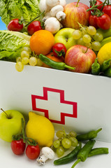 Healthy food. First aid box filled with fresh fruits and vegetab
