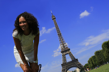 Beautiful girl jumping on the Eiffel tower