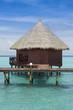 Over water bungalow in blue ocean