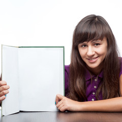 attractive caucasian smiling girl holding book