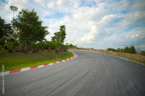 Foto op Plexiglas Motorsport racetrack straight to the mountain with the clear sky.