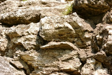 Stones rock poorody stacked together (wall fragment)