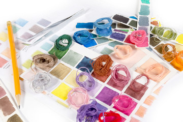 Needlework. Embroidery. Match colors of thread.