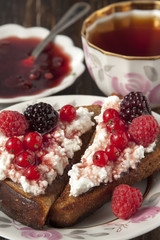 Toast of black bread with curd cream and raspberry, blackberry a