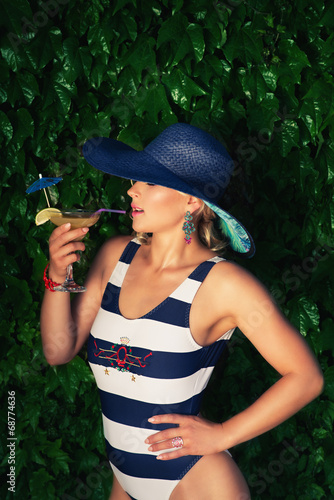 sexy girl with a summer cocktail
