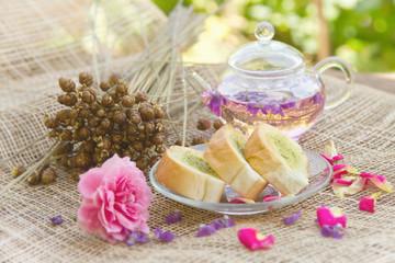 Homemade garlic bread and tea pot in the garden,afternoon tea br