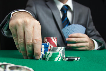 Blackjack In A Casino, A Man Makes A Bet, And Puts A Chip