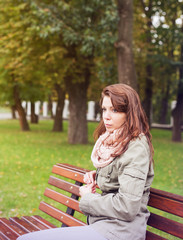 woman sitting bench outside