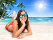 girl on the sand - in a tropical paradise island