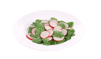 Radish salad with spinach and sesame.