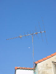 Classical television antenna with blue sky