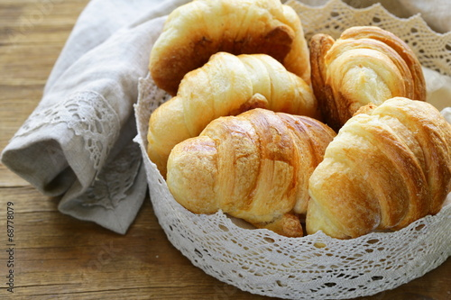 canvas print picture traditional French baking puff pastry croissants in lacy basket
