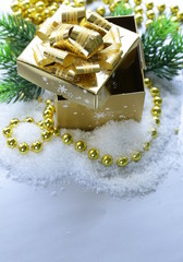 golden gift box with beautiful ribbon, christmas still life