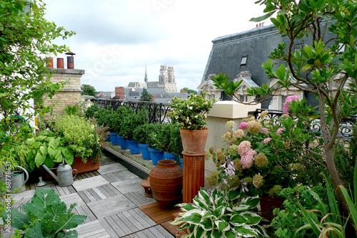 Tuinposter Tuin terrasse sur un toit d'immeuble