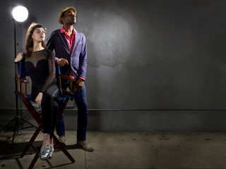 stylish actors posing on a concrete background