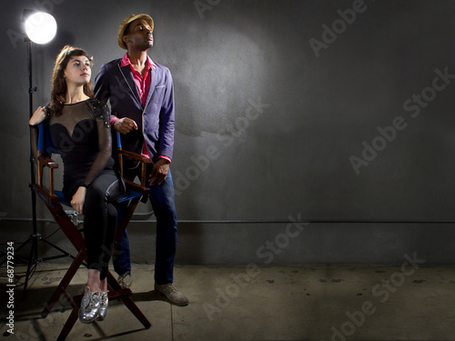 stylish actors posing on a concrete background - 68779234