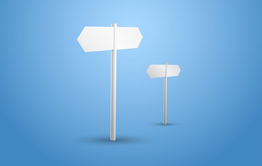 Two blank white signpost on a blue background