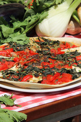 Mediterranean pizza with tomatoes and spinach