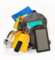 School backpack with school supplies and a tablet with headphon