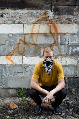 Young rebel on graffiti background