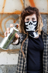 Female hooligan holding graffiti spray