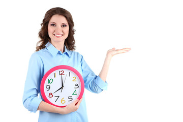 Young business woman with clock isolated on white