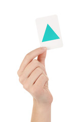 Educational card with color geometric shape in hand, isolated