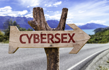Cybersex wooden sign with a street background