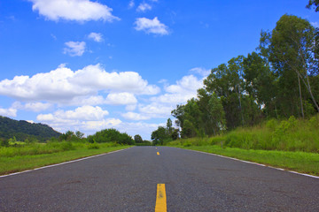 Beautiful countryside road under blue sky