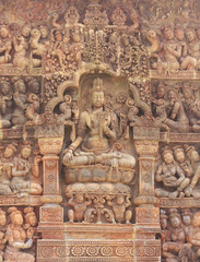 Details of sandstone carving on the wall of Angkor wat