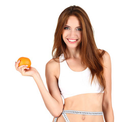 Young woman with orange and measuring tape isolated on white