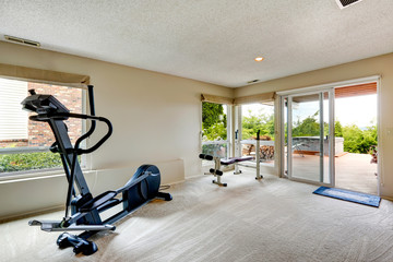 House gym room with exit to backyard