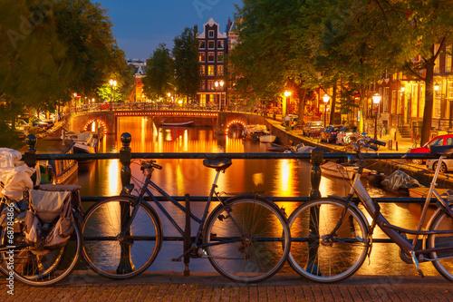 Night  illumination of Amsterdam canal and bridge - 68784866