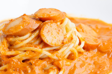 Spaghetti with sausage and tomato sauce