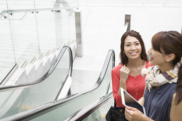 Young woman who is in escalator