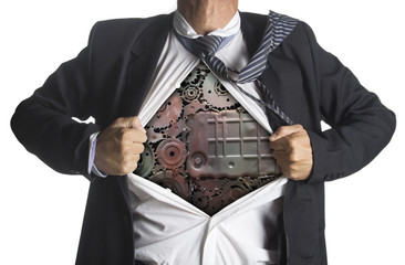 Businessman showing a superhero suit underneath machinery metal