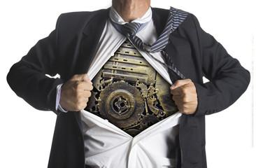 Businessman showing a superhero suit underneath machinery metal