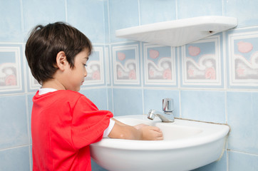 Little boy washing hand