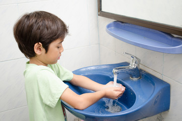 Little boy washing hand