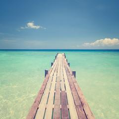Wooden bridge towards sea