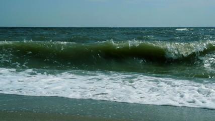 Turbulent water on a sandy coastline