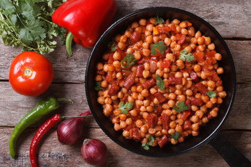 Chickpeas with chorizo in a pan with the ingredients top view